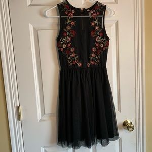 Black mini dress with rose embroidery